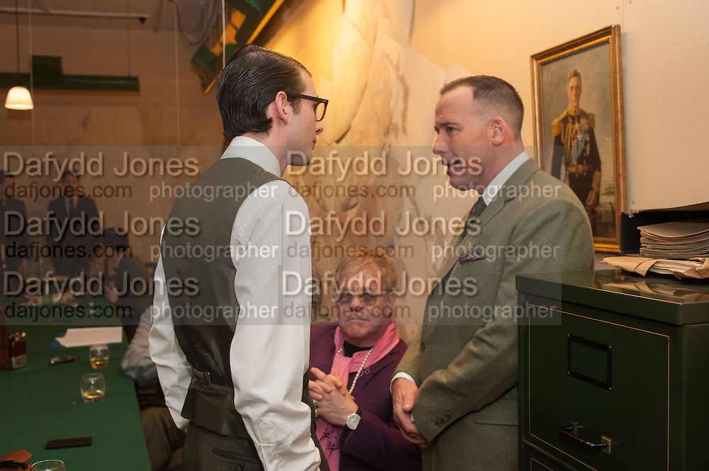 CHARLES HAMBRO; SIR ELTON JOHN; DAVID FURNISH, The English Gentleman at the  The Cabinet War Rooms, supported by Chivas deluxe blended Scotch whisky. Whitehall. London. 7 January 2013.
