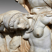 Close up of Roman Sebasteion relief  sculpture of Nero conquering Armenia depicting a fallen female representing Armenia,  Aphrodisias Museum, Aphrodisias, Turkey.   <br /> <br /> Nero, wearing only a cloak and sword strap, supports a slumped naked Armenia by her upper arms. She wears a soft eastern hat, and her bow and quiver are next to her. The heroic composition likens them to Achilles and the Amazon Queen Penthesilea. The inscription reads: Armenia - (Neron) Klaudios Drousos Kaisar Sebastos Germanikos.