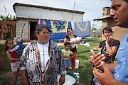 Cristian Buceanu (right), a Roma council member, elected with the support of residents from Frumusani in 2012 discussing the longtime electricity issue with inhabitans of the Roma area in Frumusani.