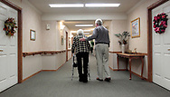 Steve LeNoir helps his mother Carrie LeNoir to her room at an assisted living home in Sumter. Due to Mrs. LeNoir's battle with Alzheimer's Disease the family felt she would be safer and better taken care of whereas before she was living alone and was prone to falling and severe confusion.