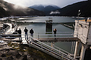 Visitors look out over the Lake Mills Reservoir formed by the Glines Canyon Dam on the Elwha River in Olympic National Park, Washington.