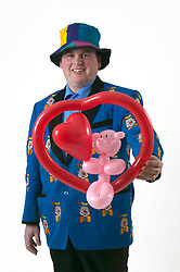 Magician performing a magic trick with balloons,