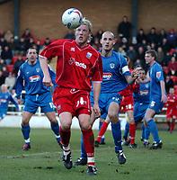 Photo: Ian Hebden.<br />Rushden & Diamonds v Grimsby Town. Coca Cola League 2. 04/03/2006.<br />Rushden's Wayne Hatswell (L) prepares to hook the ball over Grimsbys Robert Jones (R).