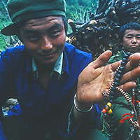 A farmer in Bayi village shows off his often-hidden rosary in the Tsangpo River Gorge, one of the deepest canyons in the world, in the Himalaya of eastern Tibet, China.