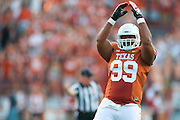 AUSTIN, TX - AUGUST 30:  Desmond Jackson #99 of the Texas Longhorns tries to pump up the crowd against the North Texas Mean Green on August 30, 2014 at Darrell K Royal-Texas Memorial Stadium in Austin, Texas.  (Photo by Cooper Neill/Getty Images) *** Local Caption *** Desmond Jackson