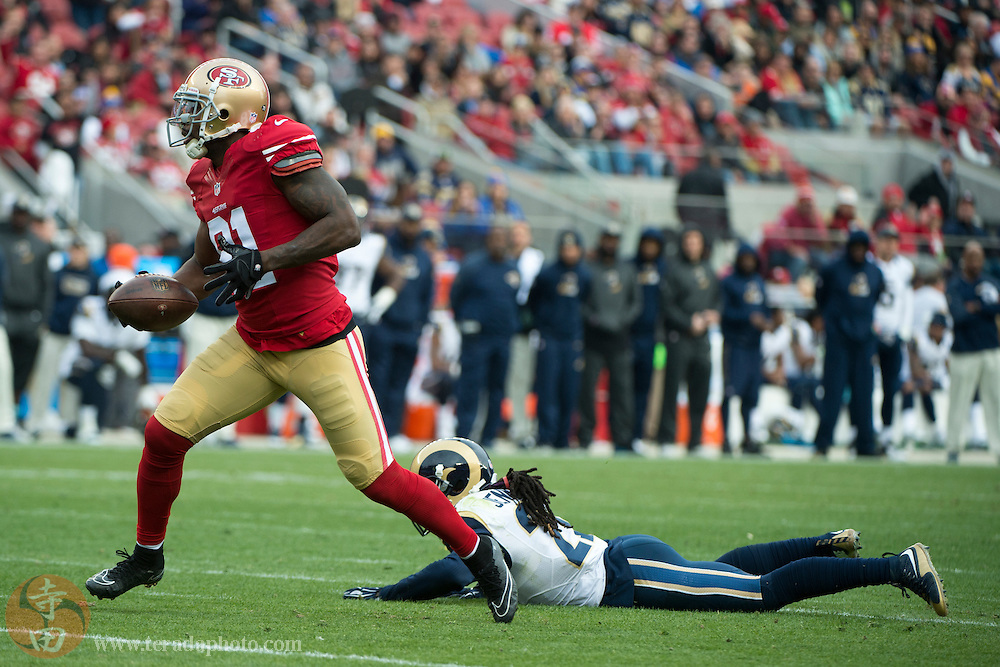 January 3, 2016; Santa Clara, CA, USA; San Francisco 49ers wide receiver Anquan Boldin (81) runs past St. Louis Rams cornerback Janoris Jenkins (21) for a touchdown during the second quarter at Levi's Stadium. The 49ers defeated the Rams 19-16.