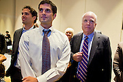 28 FEBRUARY 2012 - PHOENIX, AZ:     CRAIG ROMNEY (left) and MATT ROMNEY (center) sons of Republican presidential candidate Mitt Romney, wait with US Senator JOHN McCAIN for election results to come in Phoenix, AZ. Several hundred Romney supporters crowded into a ballroom in a Phoenix hotel to watch primary results from Michigan and Arizona. Romney won the night, scoring a tight win in the Michigan Republican Presidential primary and a comfortable win in the Arizona Republican Presidential primary.    PHOTO BY JACK KURTZ