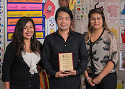 Osias Mendoza poses for a photograph with his assistants at Love Elementary School, May 20, 2015.