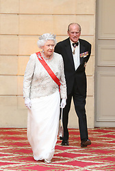 Buckingham Palace has announced Prince Philip, The Duke of Edinburgh, has passed away age 99 - FILE - Britain's Queen Elizabeth II and her husband Prince Philip arriving for a state dinner with world leaders at the Elysee presidential palace on June 6, 2014 in Paris, France, following an international D-Day commemoration ceremony on the beach of Ouistreham, Normandy, on marking the 70th anniversary of the World War II Allied landings in Normandy. Photo by Hamilton/Pool/ABACAPRESS.COM