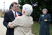 Tom Perriello, the Democratic nominee for US Representative from Virginia's 5th Congressional District, talks with his former elementary school principal Silvia Henderson before casting his vote at Meriwether Lewis elementary school in Ivy, VA.(Photo/Andrew Shurtleff)