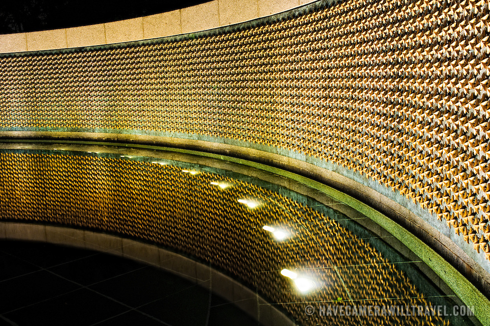 """The Freedom Wall is on the west side of the National World War II Memorial and has 4,048 gold stars, each representing 100 Americans who died in the war. In front of the wall lies the message """"Here we mark the price of freedom""""."""
