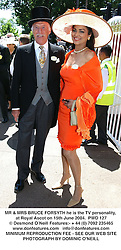 MR & MRS BRUCE FORSYTH he is the TV personality, at Royal Ascot on 15th June 2004.PWD 127