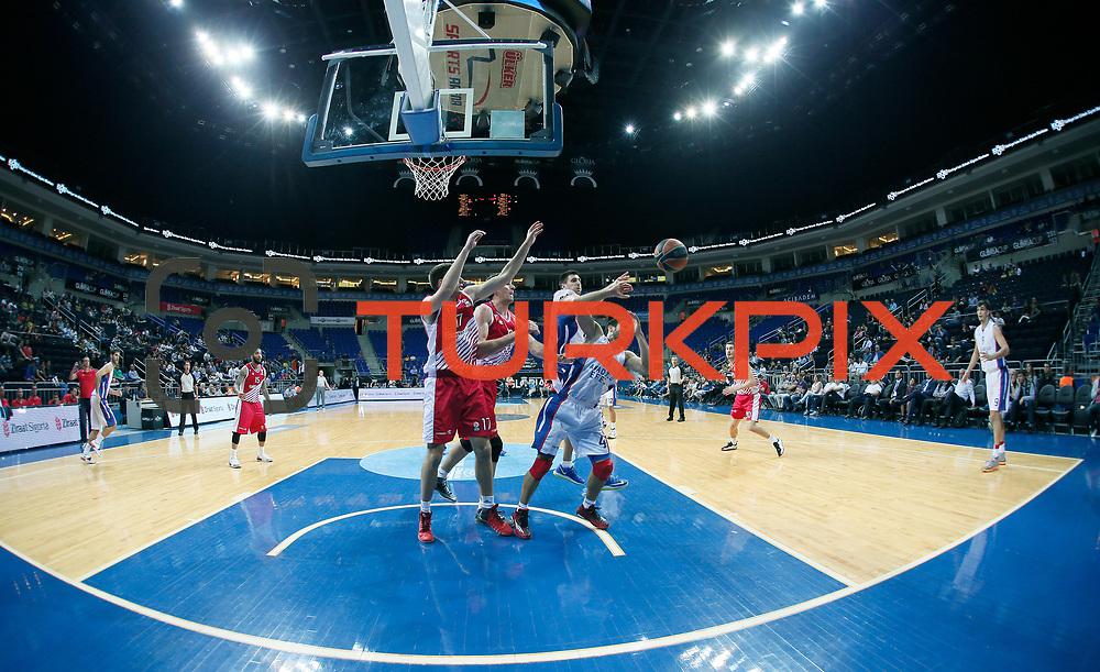 Anadolu Efes's Dogus Balbay (C) during their Gloria Cup Basketball Tournament match Anadolu Efes between Crvena Zvezda at Ulker Sports Arena in istanbul Turkey on Friday 26 September 2014. Photo by Aykut AKICI/TURKPIX