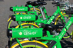 Detail of Lime E electric rental bikes on Berlin street, Germany