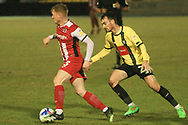 Jack Sparkes of Exeter takes on Harrogate s Jay Williams during the EFL Sky Bet League 2 match between Harrogate Town and Exeter City at the EnviroVent Stadium, Harrogate, United Kingdom on 19 January 2021.