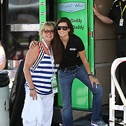 NASCAR Sprint Cup driver Danica Patrick poses with a fan by her hauler, in the garage area during the NASCAR Coke Zero 400 Sprint practice session at the Daytona International Speedway on Thursday, July 4, 2013 in Daytona Beach, Florida.  (AP Photo/Alex Menendez)