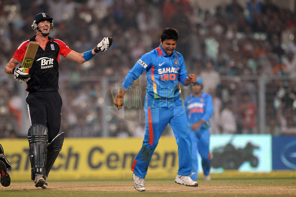 Kevin Pietersen of England reacts to the umpires decision as Suresh Raina of India celebrate his wicket during the T20 International match between India and England held at the Eden Gardens Stadium, Kolkata on the 29th October 2011..Photo by Pal Pillai/BCCI/SPORTZPICS