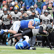 Raymond Maples, Army, is tackled during the Army Black Knights Vs Air Force Falcons, College Football match at Michie Stadium, West Point. New York. Air Force won the game 23-6. West Point, New York, USA. 1st November 2014. Photo Tim Clayton
