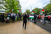 """Leicester, United Kingdom, May 20, 2021: UK based Pro-Palestinian activists' group """"Palestine Action"""" who seized control of the Leicester based factory of Elbit subsidiary UAV Tactical Systems on Wednesday, continue to occupy its rooftop for the 2nd day with activists saying that """"the occupation is aiming to be as disruptive as possible; these activists are determined to prevent Elbit from resuming its business of bloodshed."""" A dozen of people waving Palestinian flags and """"STOP BOMBING GAZA"""" placards have gathered outside the factory in support of activists standing on the rooftop. (Photo by Vudi Xhymshiti/VXP)"""