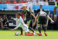 Dele Alli of  England is fouled by Joe Ledley of Wales ® as Aaron Ramsey of Wales looks on. Euro 2016, group B , England v Wales at Stade Bollaert -Delelis  in Lens, France on Thursday 16th June 2016, pic by  Andrew Orchard, Andrew Orchard sports photography.
