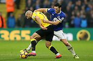 Gareth Barry of Everton challenges Nordin Amrabat of Watford .Premier league match, Watford v Everton at Vicarage Road in Watford, London on Saturday 10th December 2016.<br /> pic by John Patrick Fletcher, Andrew Orchard sports photography.