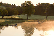 Early morning mist rising from a pond at  Firefly Farm, Hauverville, New York, U.S.A.
