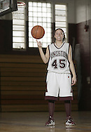 Kingston girls' basketball player Lynsey Timbrouck spins a basketball on her finger while posing for a portrait at the high school on March 26, 2007.