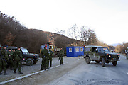 """Local Serbs, in Northern Mitrovica, open a Serbian Check point<br /> <br /> Northern Mitrovica, Kosovo<br /> Sunday, February 24, 2008<br /> <br /> Around 12/km far away from Southern Mitrovica, local Serbs from Zubin Potok suburban villages, 200metters near entrance of Qabre village populated with Albanians, put a barrack with close blue color, which means """"check point""""<br /> One of them, who doesn't preferred to tell his name says """"Here is going to be the border between Kosovo and Serbia, but what ever Kosovo is also Serbia, we will not let it go away of our hands""""<br /> On this point arrived many Danish KFOR soldiers, and situation become calm, Danish KFOR took that barrack and order Serbs to brake it away. According to some internal sources from the Serbian side, they're gone put it on next few 200metters away, from this point where they already put it today, and use to try and controlling civilian vehicles.<br /> PICTURED: Danish KFOR soldiers tripping around with them military evhicles for official patrools around New Serbian check point which check point KFOR decide to move away..<br /> Photographer VEDAT xhymshiti/ZUMApress"""