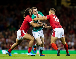 Jack Carty of Ireland is tackled by Josh Navidi of Wales<br /> <br /> Photographer Simon King/Replay Images<br /> <br /> Friendly - Wales v Ireland - Saturday 31st August 2019 - Principality Stadium - Cardiff<br /> <br /> World Copyright © Replay Images . All rights reserved. info@replayimages.co.uk - http://replayimages.co.uk
