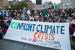 London, UK. 17 October, 2019. Climate activists from Extinction Rebellion defy the Metropolitan Police ban on Autumn Uprising protests under Section 14 of the Public Order Act 1986 by attending an XR Professionals assembly in Trafalgar Square. Activists addressed the assembly about the impact of climate change on their work.