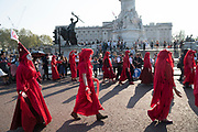 April, 21st, 2019 - London, Greater London, United Kingdom: Blood and death performance. Protesters march with skeletons of animals in danger of extinction from Parliament Square to Marble Arch. Demonstration against Climate Crisis. Extinction Rebellion is demanding the UK government takes urgent action on climate change and wildlife declines. Extinction Rebellion activists disrupt traffic around famous London Landmarks. Thousands of protesters  converging on central hubs including Oxford Circus and Parliament Square. Nigel Dickinson/Polaris