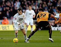 Photo: Leigh Quinnell.<br /> Wolverhampton Wanderers v Leeds United. Coca Cola Championship. 17/12/2005. Leeds' Liam Miller leaves Wolves' Tom Huddlestone behind.