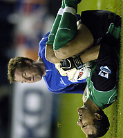 Fotball<br /> Foto: BPI/Digitalsport<br /> NORWAY ONLY<br /> <br /> 26/10/2004 <br /> <br /> Millwall v Liverpool<br /> <br /> Carling Cup 3rd Round, The New Den<br /> <br /> Jerzy Dudek reacts after  a strong tackle from Neil Harris