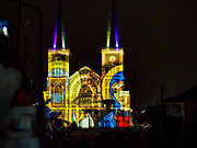 "23 DECEMBER 2018 - CHANTABURI, THAILAND: A light show representing the birth of Christ is projected on the front of the Cathedral of the Immaculate Conception during the cathedral's Christmas Fair in Chantaburi. Cathedral of the Immaculate Conception is holding its annual Christmas festival, this year called ""Sweet Christmas @ Chantaburi 2018"". The Cathedral is the largest Catholic church in Thailand and was founded more than 300 years ago by Vietnamese Catholics who settled in Thailand, then Siam.   PHOTO BY JACK KURTZ"