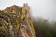 Obadiah Reid climbs the summit ridge of the First Flatiron (Direct East Face, 5.6) above Boulder, Colorado.