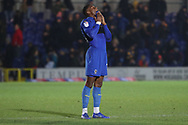 AFC Wimbledon defender Paul Kalambayi (30) with shirt in mouth and looking up during the EFL Sky Bet League 1 match between AFC Wimbledon and Barnsley at the Cherry Red Records Stadium, Kingston, England on 19 January 2019.