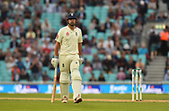 Alastair Cook of England puffs his cheeks out as he walks back to the pavilion to a standing ovation from the crowd after finishing the day unbeaten in his final test match innings during day 3 of the 5th test match of the International Test Match 2018 match between England and India at the Oval, London, United Kingdom on 9 September 2018.