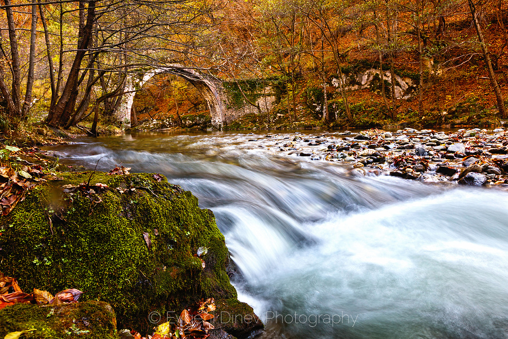 Stone bridege by a river rapid