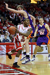 """12 January 2008: Keith """"Boo"""" Richardson charges from right to left along the baseline and gets fouled by Pieter Van Tongeren during a game in which  the Purple Aces of the University of Evansville lost to  the Redbirds of Illinois State on Doug Collins Court at Redbird Arena in Normal Illinois by a score of 74-66."""