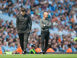 Tottenham Hotspur manager Mauricio Pochettino (L) and Manchester City manager Pep Guardiola - Mandatory by-line: Jack Phillips/JMP - 20/04/2019 - FOOTBALL - Etihad Stadium - Manchester, England - Manchester City v Tottenham Hotspur - English Premier League