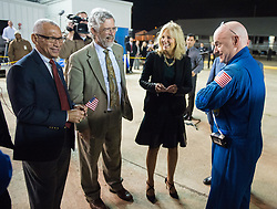 Expedition 46 Commander Scott Kelly of NASA, right, is seen with NASA Administrator Charles Bolden, left, Dr. John Holdren, director of the White House Office of Science and Technology, second from left, and Dr. Jill Biden, wife of Vice President Joe Biden, second from right, after returning to Ellington Field, Thursday, March 3, 2016 in Houston, Texas after his return to Earth. Kelly and Flight Engineers Mikhail Kornienko and Sergey Volkov of Roscosmos landed in their Soyuz TMA-18M capsule in Kazakhstan on March 1 (Eastern time). Kelly and Kornienko completed an International Space Station record year-long mission as members of Expeditions 43, 44, 45, and 46 to collect valuable data on the effect of long duration weightlessness on the human body that will be used to formulate a human mission to Mars.  Volkov returned after spending six months on the station.  Photo Credit: (NASA/Joel Kowsky)