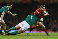 Dan Biggar of Wales is tackled by Jack McGrath of Ireland. RBS Six Nations 2017 international rugby, Wales v Ireland at the Principality Stadium in Cardiff , South Wales on Friday 10th March 2017.  pic by Andrew Orchard, Andrew Orchard sports photography