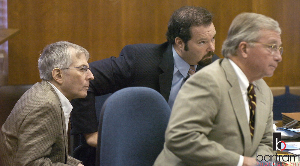 Robert Durst, left, and his attorneys Chip Lewis, center, and Dick DeGuerin listen to testimony during a hearing to remove Judge Susan Criss from the Durst case on Wednesday, Sept. 29, 2004 in Galveston, Texas.