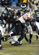 New Orleans Saints quarterback Drew Brees (9) gets gang tackled during the NFL NFC Wild Card football game against the Philadelphia Eagles on Saturday, Jan. 4, 2014 in Philadelphia. The Saints won the game 26-24. ©Paul Anthony Spinelli