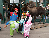 From left, Blake, Anna, Lian and Jaclyn McNaughton grab a selfie with the moose at Jackson Mercantile on Tuesday while trick-or-treating at the Town Square. Hundreds of kids and grown-ups donned spooky and silly costumes and visited Jackson businsses to gather tasty treats.