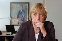 21 AUG 2003, BERLIN/GERMANY:<br /> Angela Merkel, CDU Bundesvorsitzende und Vorsitzende der CDU/CSU Bundestagsfraktion, waehrend einem Interview, in ihrem Buero (im Hintergrund ein Bild von Konrad Adenauer), Jakob-Kaiser-Haus, Deutscher Bundestag<br /> IMAGE: 20030821-01-012