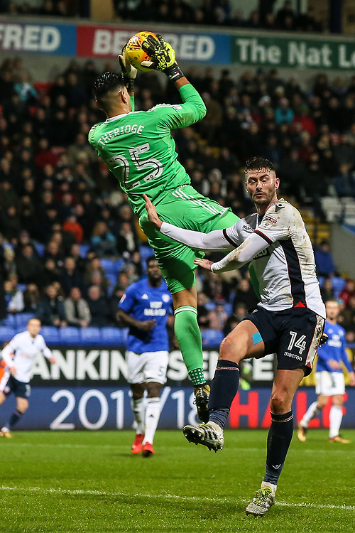 Bolton Wanderers' Gary Madine competing for the ball with Cardiff City's goalkeeper Neil Etheridge <br /> <br /> Photographer Andrew Kearns/CameraSport<br /> <br /> The EFL Sky Bet Championship - Bolton Wanderers v Cardiff City - Saturday 23rd December 2017 - Macron Stadium - Bolton<br /> <br /> World Copyright © 2017 CameraSport. All rights reserved. 43 Linden Ave. Countesthorpe. Leicester. England. LE8 5PG - Tel: +44 (0) 116 277 4147 - admin@camerasport.com - www.camerasport.com