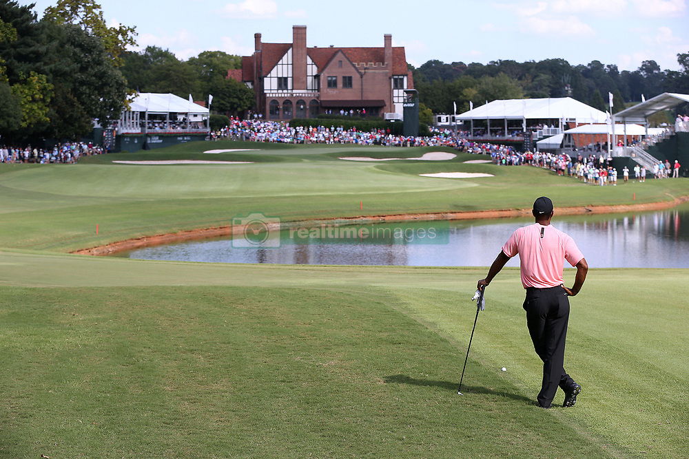 September 20, 2018 - Atlanta, GA, USA - Tiger Woods contemplates his fairway shot to the 18th green, where he made a birdie to finish 5-under par, during the first round of the Tour Championship on Thursday, Sept. 20, 2018, in Atlanta, Ga. (Credit Image: © Curtis Compton/Atlanta Journal-Constitution/TNS via ZUMA Wire)