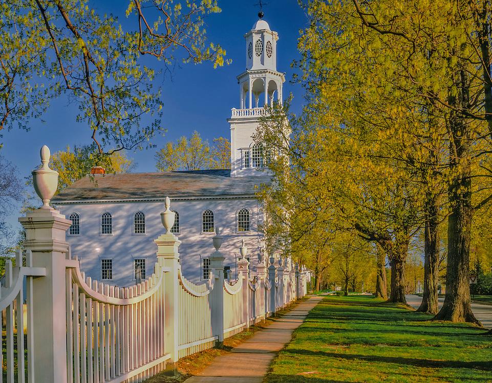 Ornate fence leads to church & spring greens, Bennington, VT