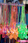 Shop with racks of toy fluorescent Coke bottles and cell phones Hmong Sports Festival McMurray Field St Paul Minnesota USA